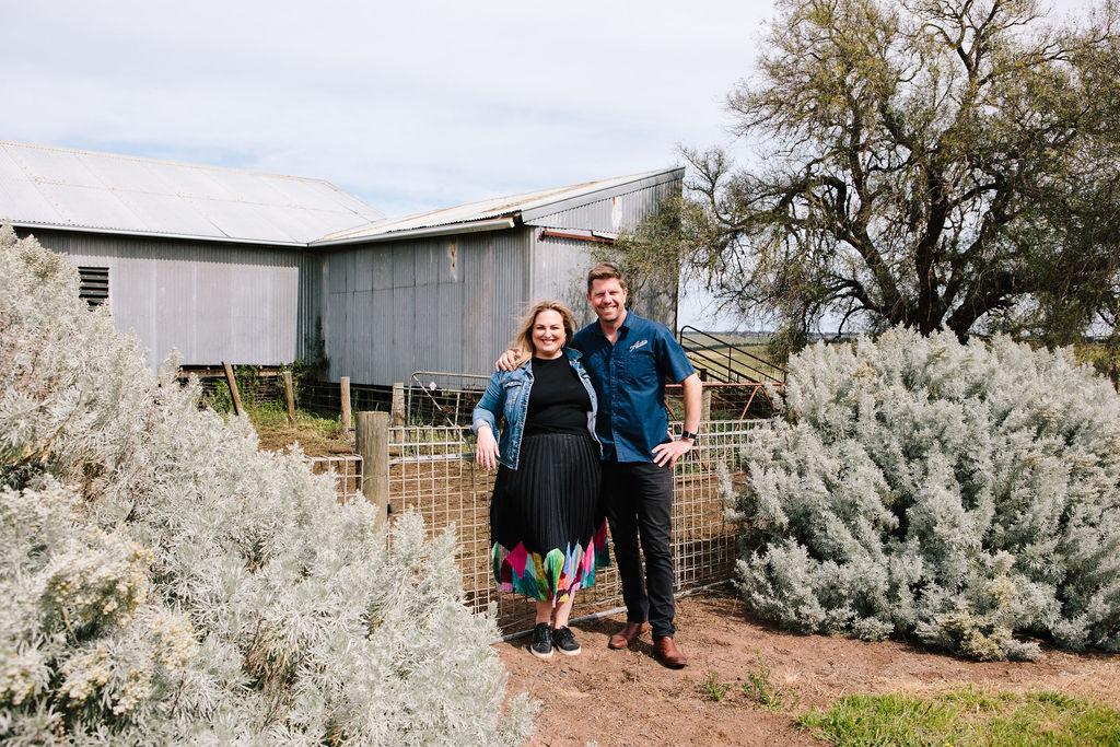Scott and Belinda Austin in front of the Cellar Door site
